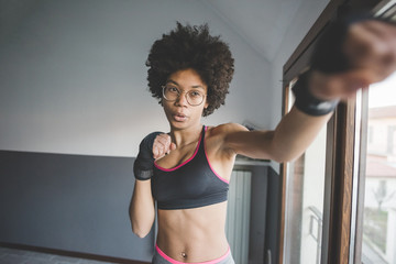 Young mixed race woman boxing