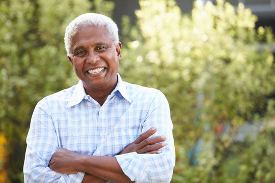 Smiling senior African American man with arms crossed