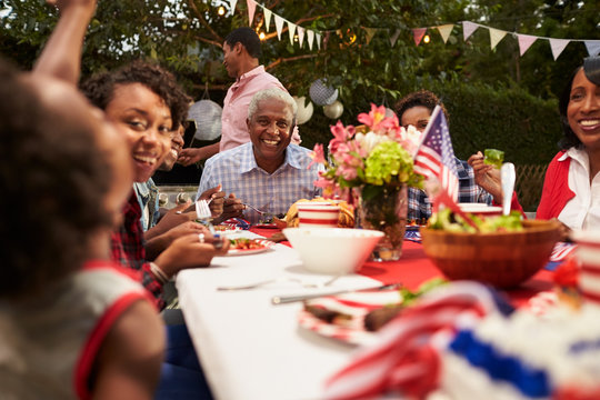 Multi generation black family at 4th July barbecue, close up