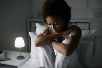 Depressed woman in her bed