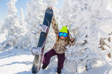 Portrait of young smiling woman with snowboard