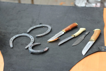 knives and horseshoes on the table