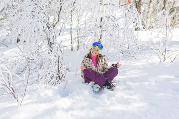 Portrait of young smiling woman meditating on snow
