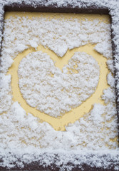 The symbol of the heart, painted on the fresh white snow