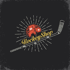 Retro logo for the hockey shop - stick, helmet and inscription. Layered vector illustration - grunge texture, text, background separately and can be easily disabled.