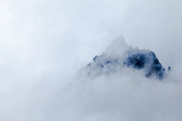 Mountain peak and cloud