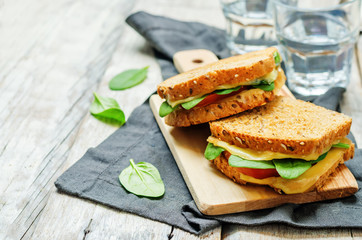 Spinach tomato cheese grilled rye sandwiches