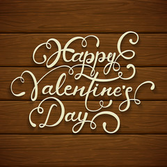 Happy Valentines Day on brown wooden background