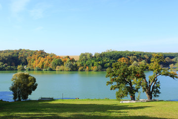 beautiful autumnal landscape with lake and trees