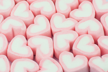 Pink heart shaped marshmallows background