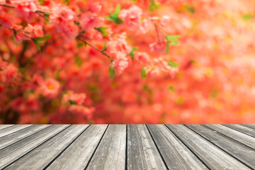 Wood table top and blurred flowers background