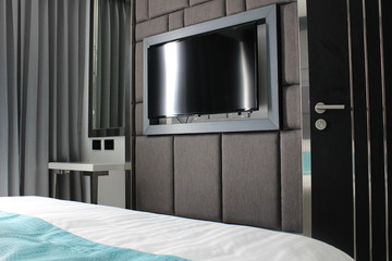 TV Screen in a Modern Apartment's Bedroom