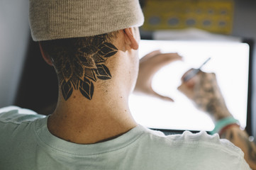 Tattoo master working with sketch