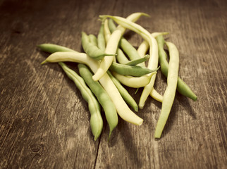 Green beans on a wooden table