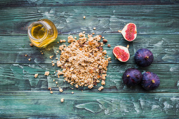 Healthy Breakfast. Muesli, honey and figs on a wooden table.