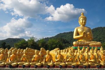 Buddha image of Lord buddha among the 1,250 monks, the symbol of Magha Puja day, Buddha Memorial park, Nakorn nayok, Thailand