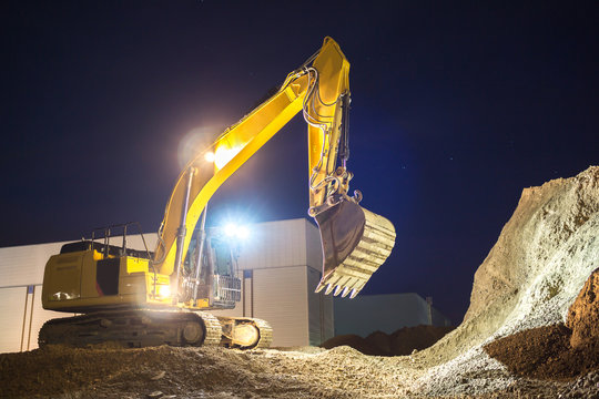 excavator at night