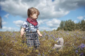 Little boy walking in the garden
