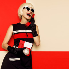 Happy Retro Blonde in vintage clothes and retro telephone. Minim
