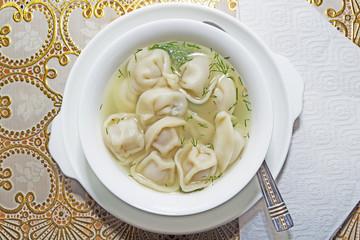 Traditional Russian Siberian pelmeni in soup