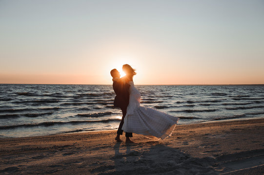 Just Married. Beautiful young couple on the beach at sunset