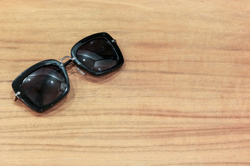 Sunglasses on the wooden table with copy space