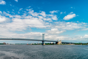 View on Delaware river and Benjamin Franklin Bridge. Bridge – is a suspension bridge across the Delaware River connecting Philadelphia, Pennsylvania, and Camden, New Jersey.