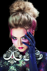 Young attractive blonde girl in bright art-makeup, high hair, body painting. Palm on the face