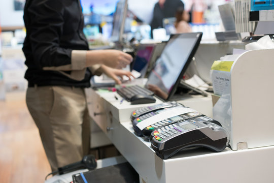Man using pos terminal at the shop (paying credit card for purch