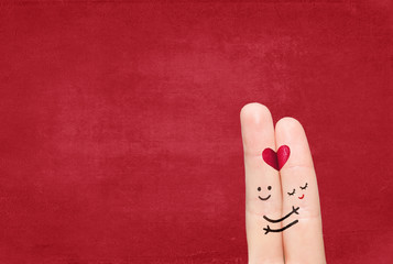 Couple in love with your finger on a solid background. Wall mural