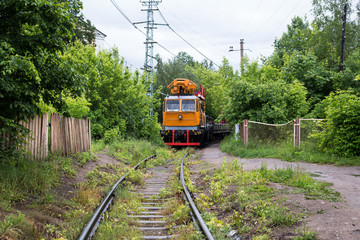 Russian railway turnouts, rails and bonding in the old grass in the summer