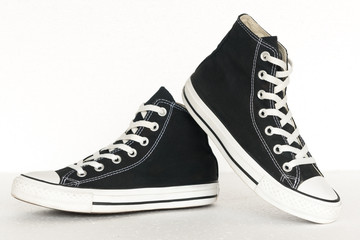 vintage style of sport black and white sneaker shoes on white ba