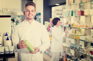 Portrait of two glad pharmacists