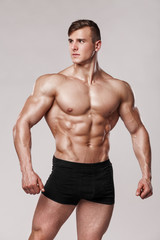 Sexy muscular man fitness model in underwear. Strong male naked torso abs