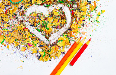 heart, colored pencils and shavings
