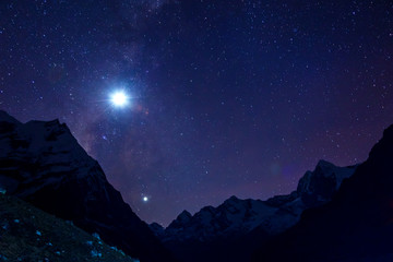 Night Sky with bright Moon and Mountain Ridge