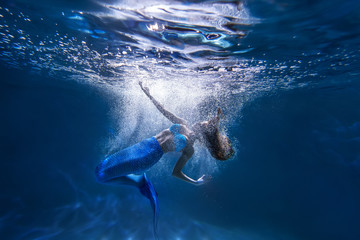 Underwater shot with free diver girl with mermaid tale