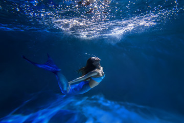 Underwater shot with free-diver girl with mermaid tale