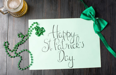 Happy St Patrick day calligraphy card on black