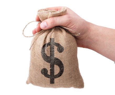 Loans for real estate concept. Hand with bag  giving money to another hand