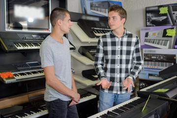 Young men looking at keyboards