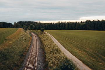 railroad in landscape between fields, green, nature