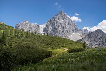 Mountain hiker in alpine landscape, Austria