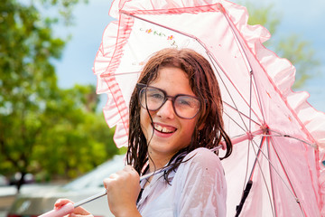 Wet Girl Holding Frilly Umbrella and Wearing Water Spotted Glass