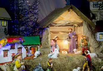 Christmas nativity scene with figurines including Jesus, Mary, J