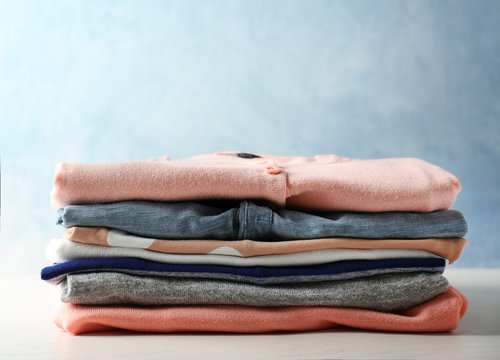 Stack of colorful clothes on light background