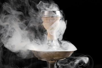 smoke hookah on a black background with a beautiful smoke
