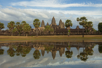 Classic view of Angkor Wat temple reflecting in the pond lake