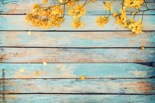 Wall mural Yellow flowers on vintage wooden background, border design. vintage color tone - concept flower of spring or summer background