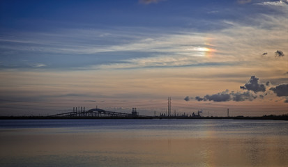 Bridges and rainbow at sunset